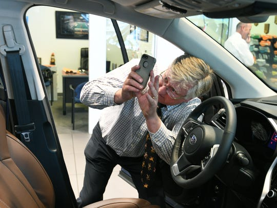 Grayson Subaru Hyundai salesman John Peterson takes photos of the new unveiled 2019 Subaru Ascent Wednesday, May 23, 2018 in their showroom.