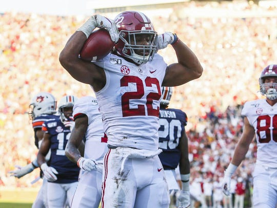 Nov 30, 2019; Auburn, AL, USA; Alabama Crimson Tide running back Najee Harris (22) reacts after scoring a touchdown during the second quarter against the Auburn Tigers at Jordan-Hare Stadium. Mandatory Credit: John Reed-USA TODAY Sports