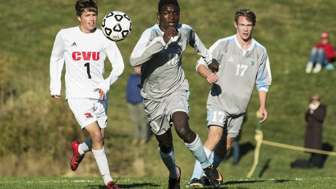 South Burlington's Amerlin Nemeye (10) and CVU's Dillon Hamrell (1) chase after the ball during the high school boys soccer game between the South Burlington Rebels and the Champlain Valley Union Redhawks on Monday afternoon in Hinesburg.