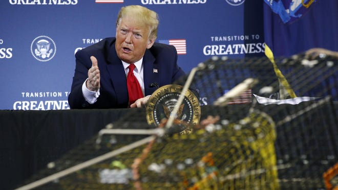 President Donald Trump speaks during a roundtable discussion with commercial fishermen at Bangor International Airport in Bangor, Maine, Friday, June 5, 2020.