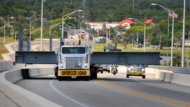 A giant platform headed for the VAB makes its way slowly over the Max Brewer Bridge in Titusville on its way to the Kennedy Space Center.
