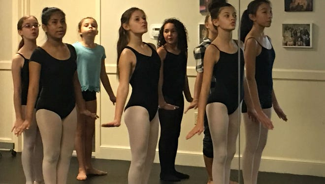 """Local ballerinas view themselves in the mirror as they rehearse the manatee dance for """"The Nutcracker on the Indian River."""""""