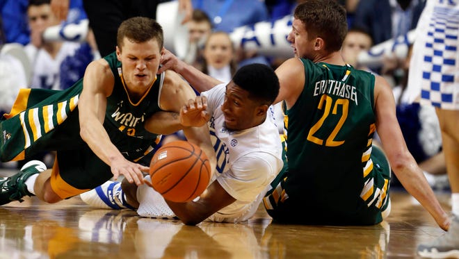 Wright State Raiders guard Grant Benzinger (13), the son of former Reds infielder Todd Benzinger, and Kentucky Wildcats forward Marcus Lee (0) dive for a loose ball in the first half at Rupp Arena.
