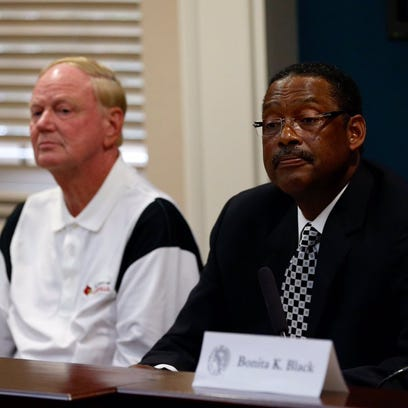 U of L President James Ramsey, left, and Chairman Pro
