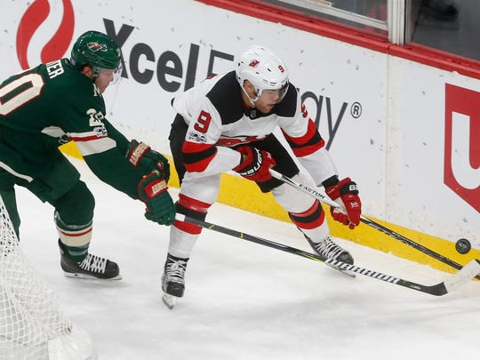 Minnesota Wild's Ryan Suter, left, and New Jersey Devils' Taylor Hall race for the puck in the first period of an NHL hockey game Monday, Nov. 20, 2017, in St. Paul, Minn. (AP Photo/Jim Mone)