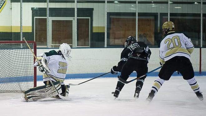 Howell goalie Nathan George makes one of his 22 saves on a shot by Eric Budd of Ann Arbor Gabriel Richard.