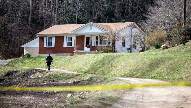 "Buncombe County sheriff's deputies investigate the home of Joseph ""J.T."" Codd, 45, and his wife, Cristie Schoen Codd, 38, in Leicester on March 17."