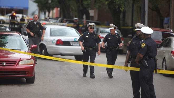 Police investigate the scene of Friday's shooting on Orchard Street.