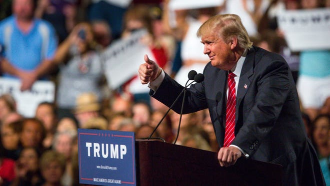 Republican presidential candidate Donald Trump addresses supporters in Phoenix on July 11, 2015.