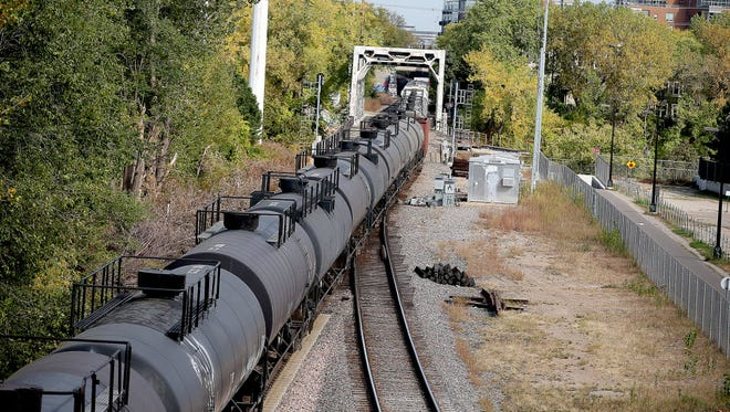 A train moves along tracks near downtown Minneapolis on Oct. 6, 2015. Trains carrying at least 1 million gallons of oil from North Dakota have been entering the Twin Cities more often on a route that goes through downtown Minneapolis.
