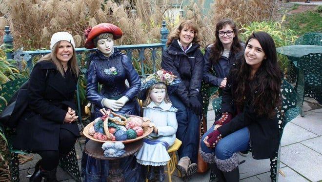 Mother Ann-Marie DeStefano, aunt Kim DeStefano, Tara and Cassidy DeStefano pose with a sculpture in the gardens.