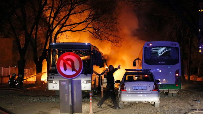 A police officer gestures as he walks at the site of an explosion after an attack targeted a convoy of military service vehicles in Ankara on Feb. 17.