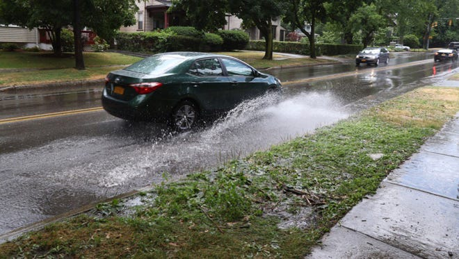 Heavy rains caused street flooding Rochester Monday afternoon.
