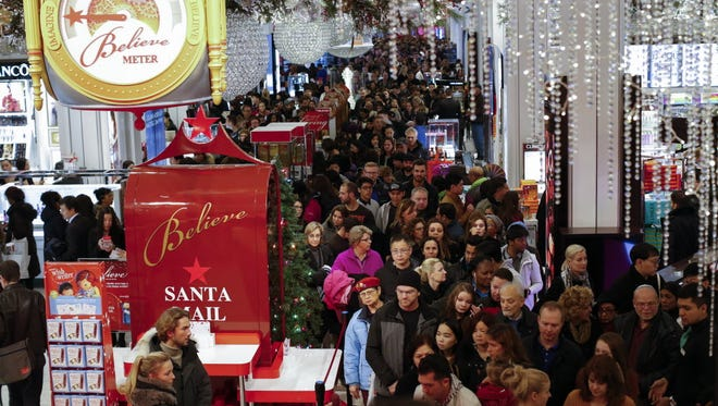 Shoppers shop around the holiday time