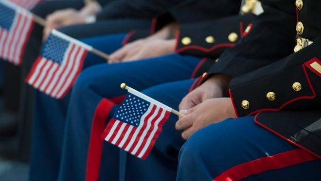 U.S. troops and veterans  during a naturalization ceremony in 2014 in Triangle, Va.