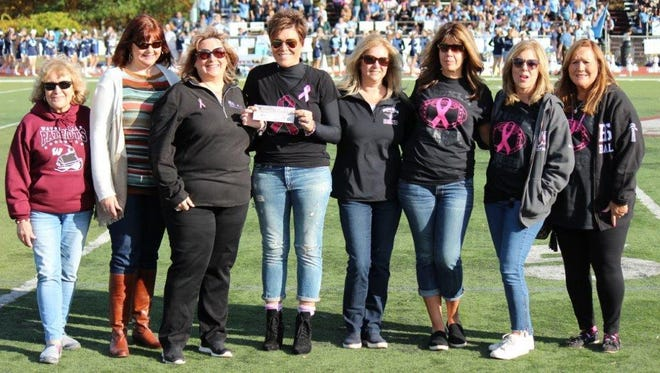 Honored at halftime: (from left) Carol Zaccone, a breast cancer survivor; Sandy Balentine and Valerie Quigley, from Valley Hospital Breast Center; survivors and Wayne residents Lia Maguire, Barbara Mazza, Terri LoVerde, Allyson Garrone and Donna Warther.