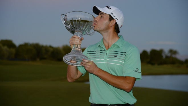 Patrick Cantlay poses with the winner's trophy after winning the Shriners Hospitals For Children Open at the TPC Summerlin in Las Vegas.