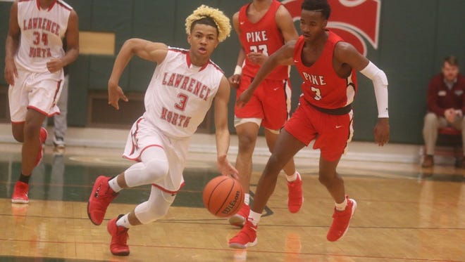 Lawrence North's Michael Saunders brings the ball up the court in the Wildcats' 62-52 win over Pike.