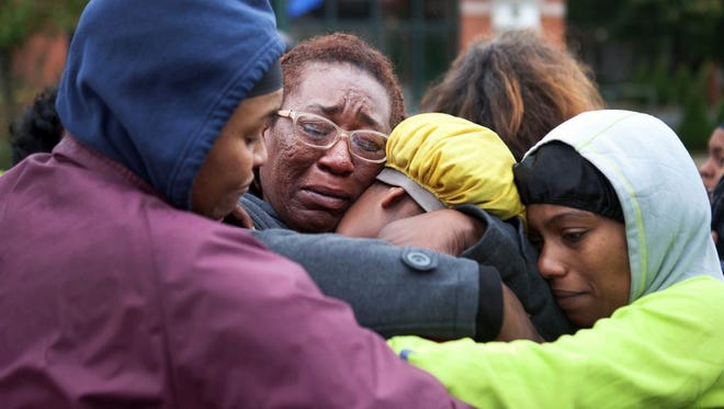 Residents grieve the scene of a fatal shooting in Rochester.