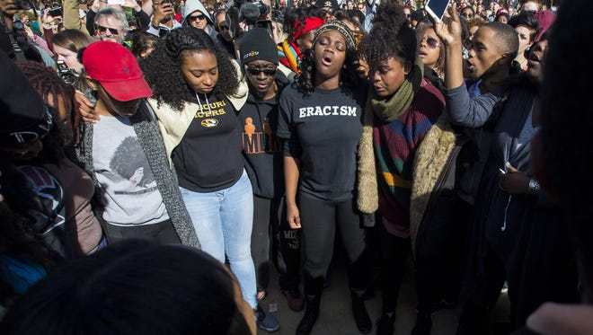 Members of Concerned Student 1950 celebrate after the resignation of Missouri University president Timothy M. Wolfe on the Missouri University Campus November 9, 2015 in Columbia, Missouri. Wolfe resigned after pressure from students and student athletes over his perceived insensitivity to racism on the university campus.
