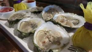 Fresh-shucked Malpeque oysters are served with lemon halves, cocktail sauce and mignonette sauce at Joe Muer Seafood in downtown Detroit.