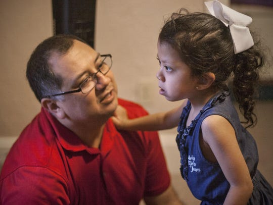 David Hernandez, left, spends time with his daughter,