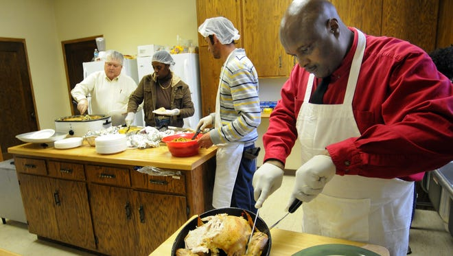 Volunteers work in the kitchen at Divine Temple Church of God in Christ to prepare its annual Thanksgiving dinner for the community in 2009. The downtown Green Bay church at 425 Cherry St. will serve its annual Community Thanksgiving Dinner from noon-2 p.m. Thursday.
