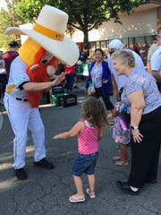 Homer, the mascot for the Redding Colt 45s, had a lot of fans at Friday's pancake breakfast.