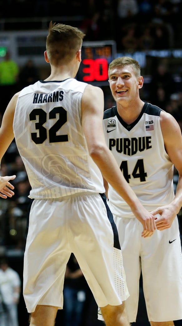 Isaac Haas of Purdue celebrates with Matt Haarms after