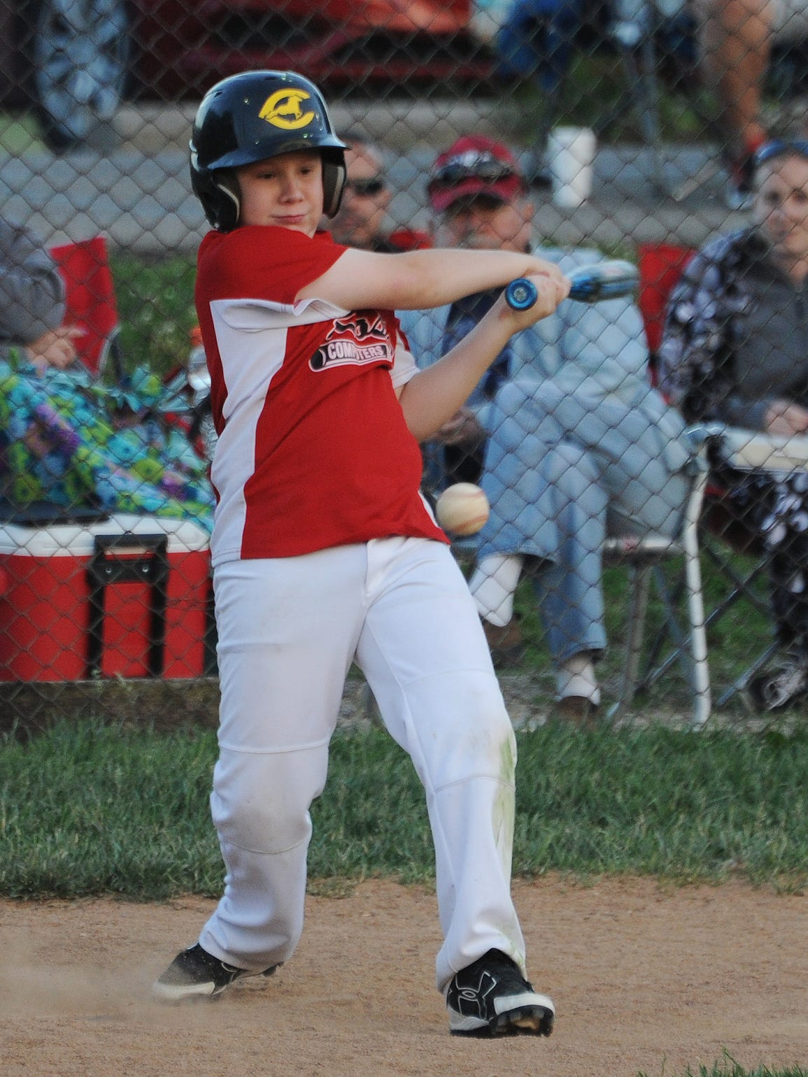 TJ Barr hits the ball during a game Tuesday, June 7,