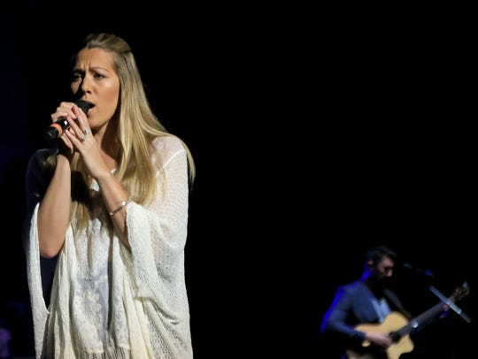 Colbie Caillat sings as her fiancé, Justin Young, plays