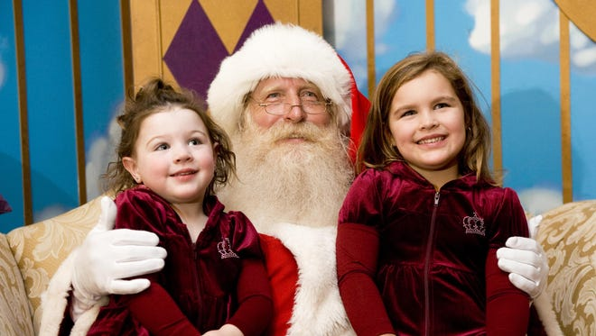 File: Abby Leporati (left) and her sister Ava of Cherry Hill have their photo taken with Santa at the Cherry Hill Mall.