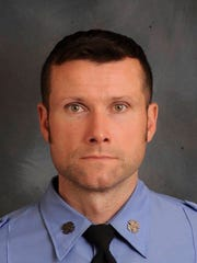 This photo provided by New York Fire Department shows FDNY Firefighter Michael R. Davidson of Engine Company 69.