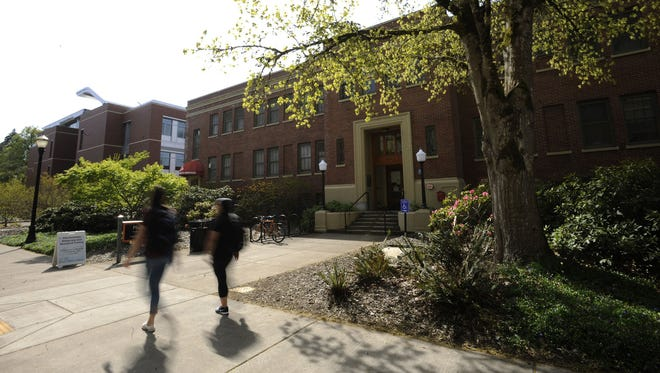 Oregon State University students walk past the Student Health Services building