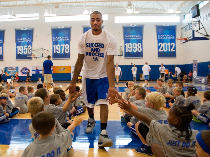 Former UK star James Young was on hand to play ball with kids attending the John Calipari Basketball Procamp at UK.  (July 29, 2014)
