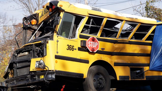 A school bus is carried away Nov. 22, 2016, in Chattanooga from the site where it crashed. The crash killed six elementary school students.