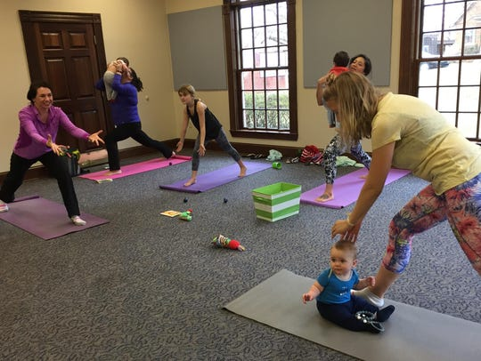 Phoenix Wilson leads yoga class for young mothers and
