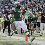 UAB running back Jordan Howard scores a touchdown against Marshall last Nov. 22 in Birmingham, Ala. UAB president Ray Watts says the school is bringing back its football program, possibly as early as the 2016 season.