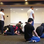 Students use a prayer room for one of the five daily prayers required in the Islam religion.