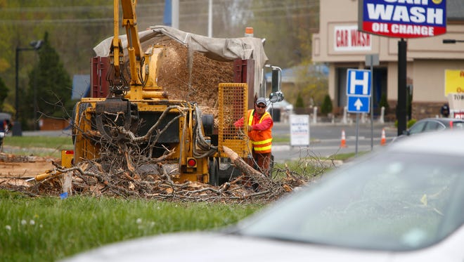 Trees are cleared from the center of the Asbury Circle on the Neptune and Ocean Township borders Wednesday.