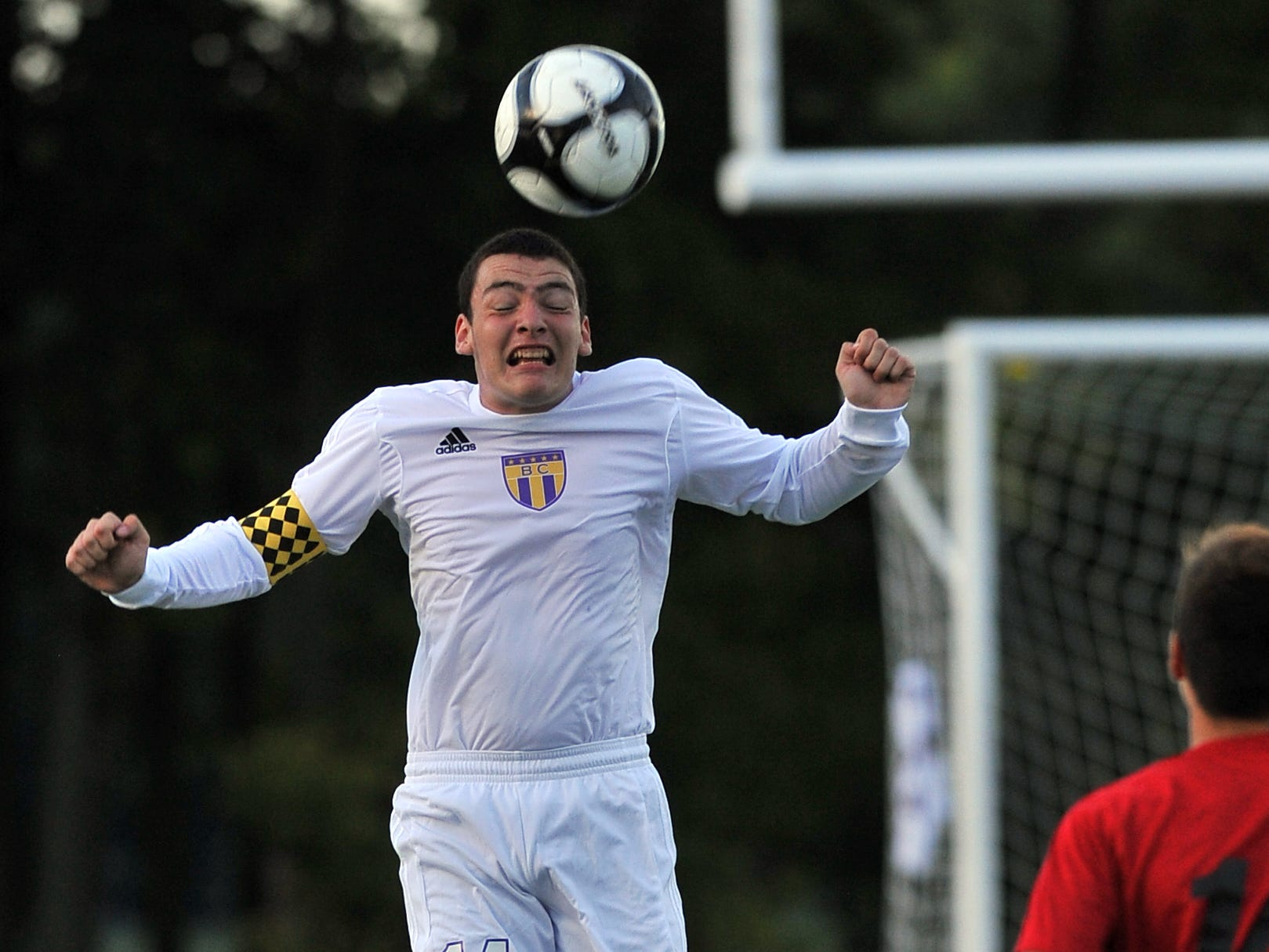 Bloom-Carroll's Justin Smith heads the ball during a nonleague game against Big Walnut.