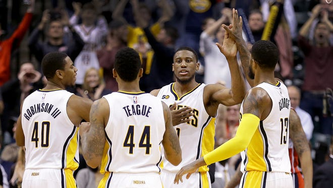 Indiana Pacers forward Thaddeus Young (21) high-fives his teammates after hitting the game winning shot late in the second half of their game Monday, December 19, 2016, evening at Bankers Life Fieldhouse. The Pacers defeated the Wizards 107-105.