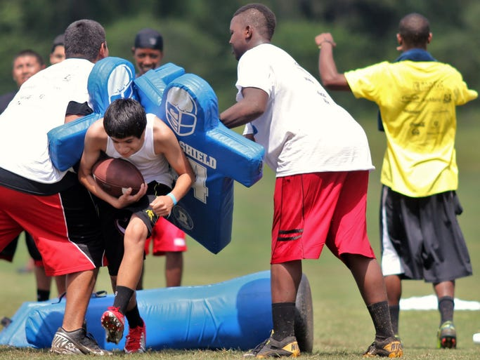 Scenes from the Edgerrin James Football Camp held at Ave Maria Monday afternoon. The camp featured coaches with experience at the college and professional levels for players ranging from 6 years old to the  high school level.