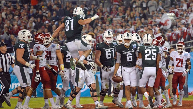Michigan State Spartans quarterback Damion Terry (6) celebrates after scoring during the third quarter against the Washington State Cougars in the 2017 Holiday Bowl at SDCCU Stadium.