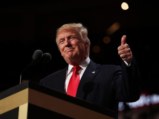 Republican presidential candidate Donald Trump gives a thumbs-up to the crowd during his speech on the fourth day of the Republican National Convention on July 21, 2016, at the Quicken Loans Arena in Cleveland.