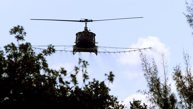 Lee County Mosquito Control District sprays  over St. James City
