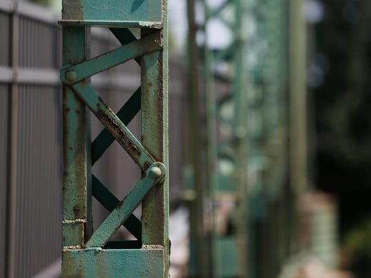 Signs of deterioration are visible Friday, Aug. 21, 2015 on the Jackson Street Bridge near Southwest Fifth Street in Des Moines.