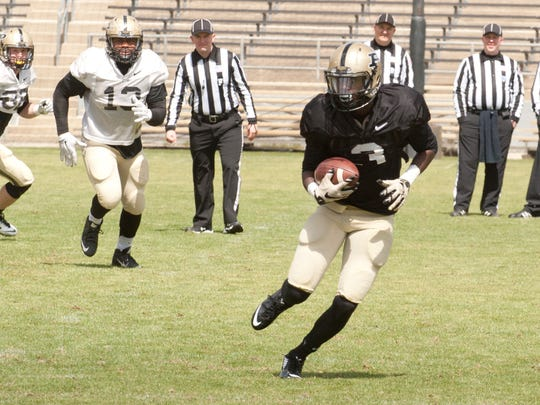 Purdue wide receiver Bilal Marshall makes a cut upfield