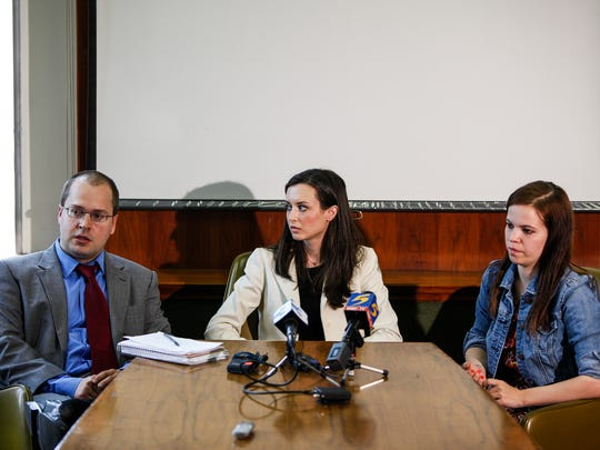 April 2 2014 - Attorney Daniel Lofton, from left, and plaintiffs Meaghan Ybos and Madison Graves address members of the media during a press conference about a lawsuit filed in regards to their case.