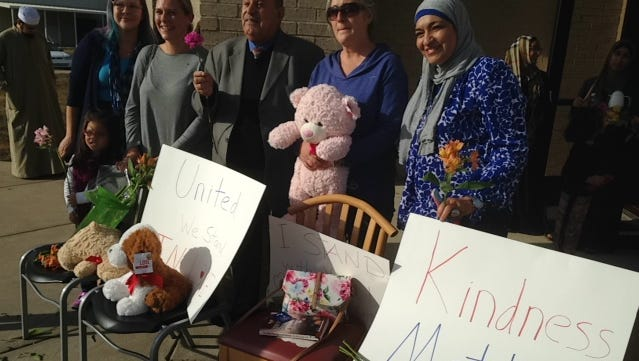 "Supporters of the Islamic Center of Murfreesboro pose with ICM members in a Love Display that includes stuffed animals and signs with encouraging words, such as ""Kindness Matters."" The Love Display took place following Friday's worship service and after an Election Day that made Republican Donald Trump the next president."